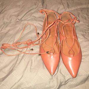 Orange strappy shoes